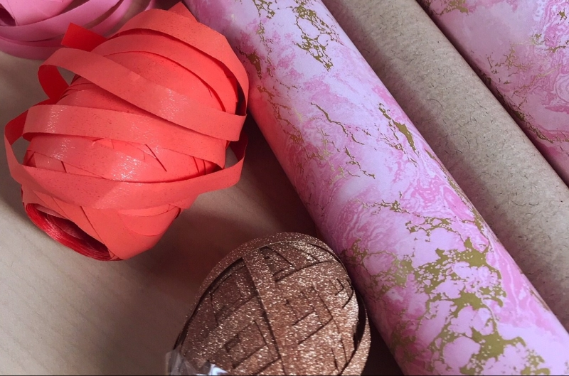 Gift wrapping rolls peach gold ribbons