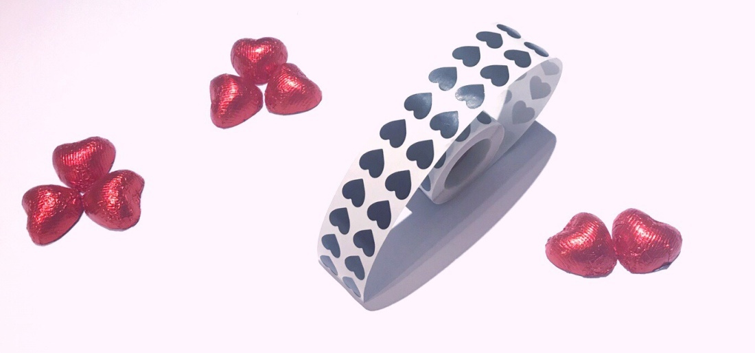 Black heart sticker roll and red heart chocolate