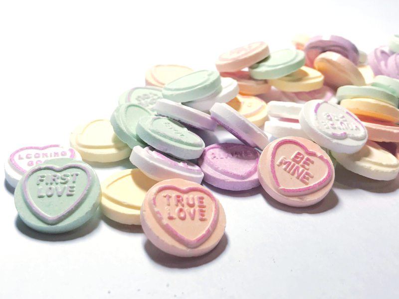 Scattered love-heart sweets